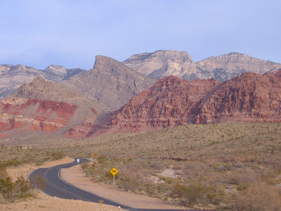 The Keystone Thrust, which resulted in the older gray igneous rocks of the La Madre Mountains being flung up on top of younger red and white sandstone deposits of the Calico Hills