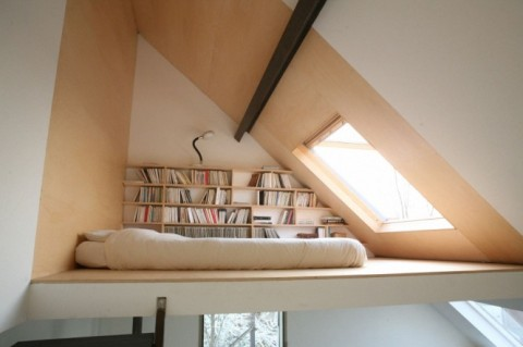 Attic bedroom with bookshelves